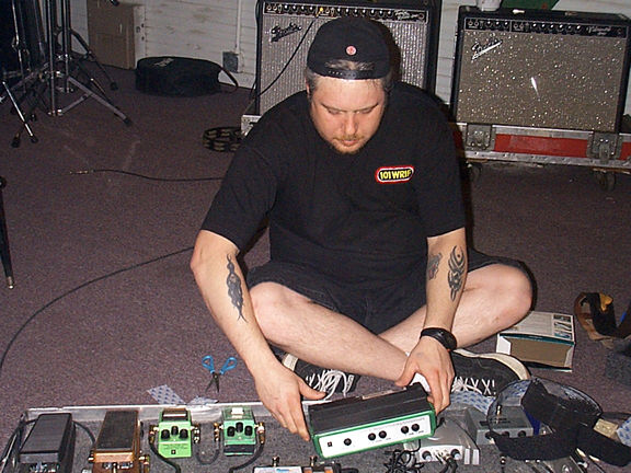 Roy with the pedalboard, getting ready for the tour.