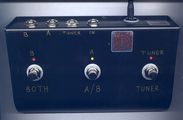 tuner, ab both box  tuner kills both outputs  when tuner off, you can  choose a, b, or both